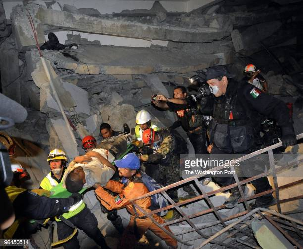 A teacher named Jean Baptist is rescued from the St Gerard Technical School by a rescue team from Mexico on January 16 2010 in PortAuPrince Haiti...