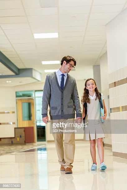 teacher or principal walks student to class - charter_school stock pictures, royalty-free photos & images