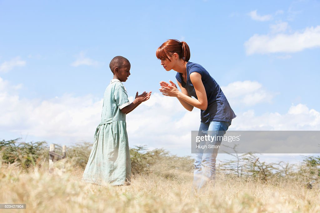 Teacher playing with school girl, Kenya : Stock Photo
