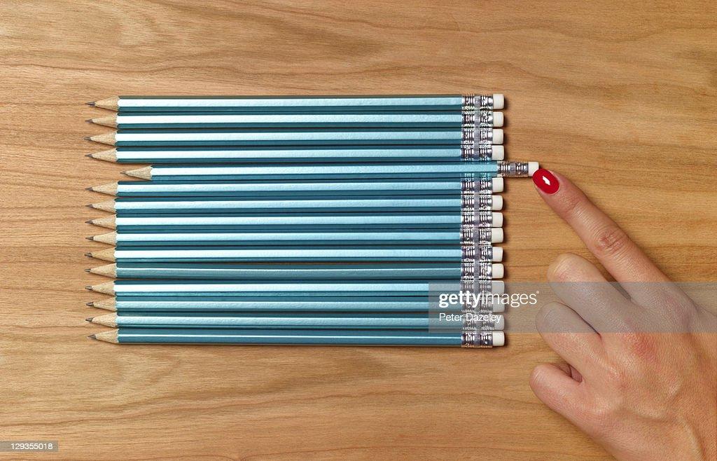 Teacher preparing pencils for school day : Stock Photo