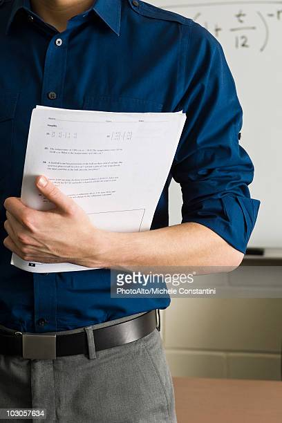 Teacher preparing to hand out exams