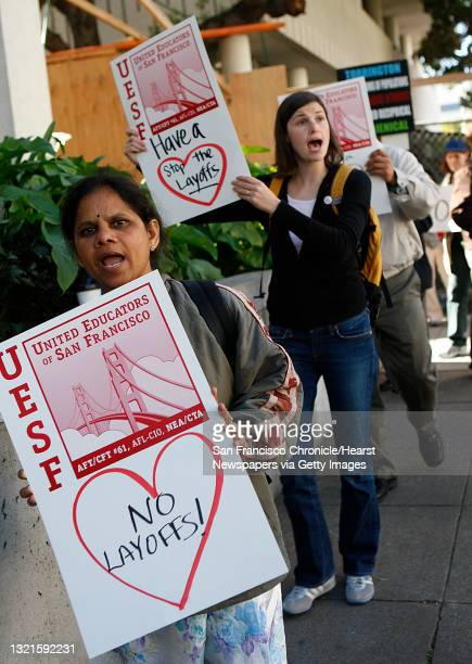 Teacher Pushpa Yelisetty, from Grattan Elementary, and Courtney Lindl , choir teacher at A.P. Giannini protest layoffs with other teachers and...