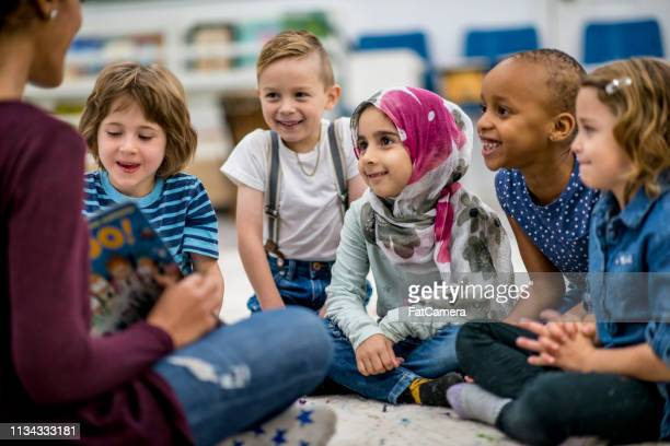 teacher reading a book - storytelling stock pictures, royalty-free photos & images