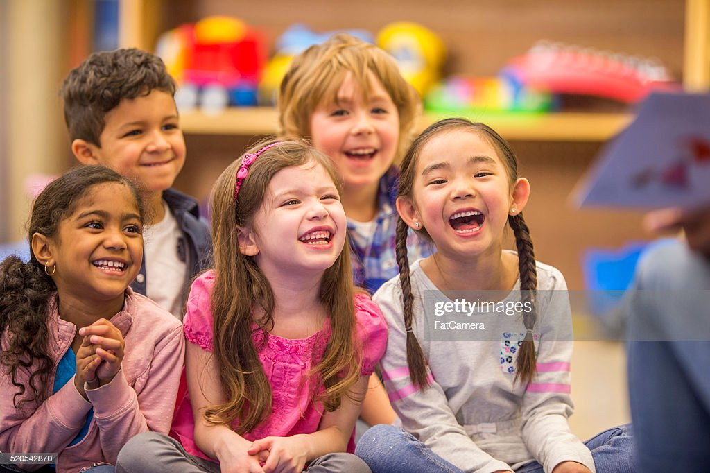 Teacher Reading a Story to Her Students : Stock Photo