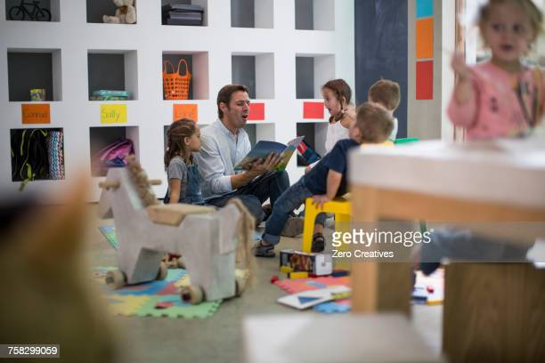 teacher reading to children - preschool student stock pictures, royalty-free photos & images