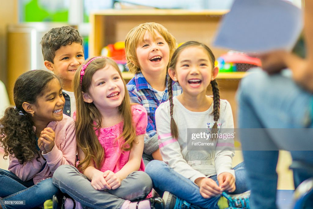 Teacher Reading to Her Students : Stock Photo