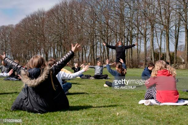 Teacher Rebekka Hjorth has music lessons with her 5.A class outdoors at the Korshoejskolen Public school in Randers, Denmark on, April 15, 2020. -...