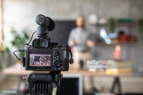 teacher recording video for e-learning class - stream stock pictures, royalty-free photos & images
