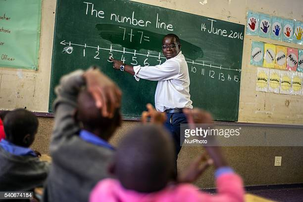 A teacher Richard Tjaronda shows easy way of counting with the number line for his learners during Mathematic lesson at Eluwa Special School in...