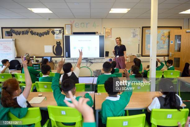 Teacher Ruth Titmus leads a maths class for Year Four children in their classroom at Greenacres Primary Academy in Oldham, northern England on...