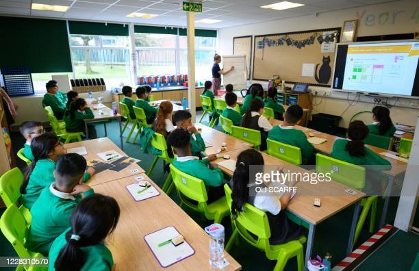 Teacher Ruth Titmuss leads a maths class for Year Four children in their classroom at Greenacres Primary Academy in Oldham, northern England on...