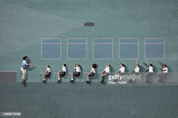 "teacher & school children in uniforms ""sitting"" in graphic drawn imaginary classroom - educazione primaria foto e immagini stock"