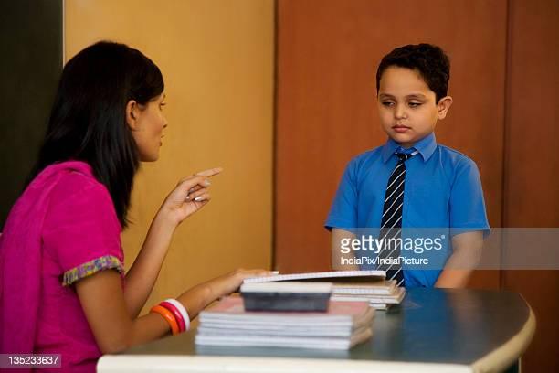 Teacher scolding a student