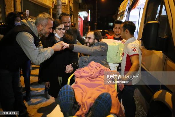 Teacher Semih Ozakca is welcomed by his friends and neighbours as he arrives at his home after being released on parole from the Sincan prison on...