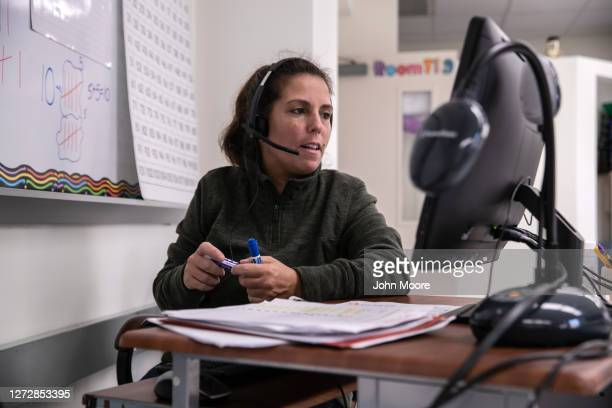 Teacher Shira Mandel instructs first grade students during a remote learning class at Stark Elementary School on September 16, 2020 in Stamford,...