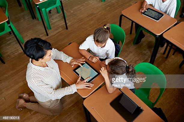 teacher showing kids map on tablet - looking down her blouse stock photos and pictures