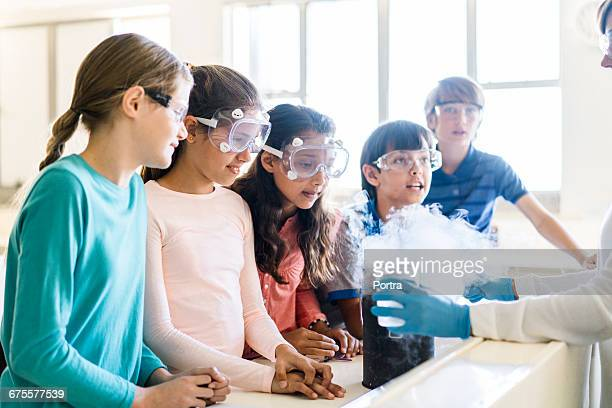 teacher showing scientific experiment to students - chemistry stock pictures, royalty-free photos & images