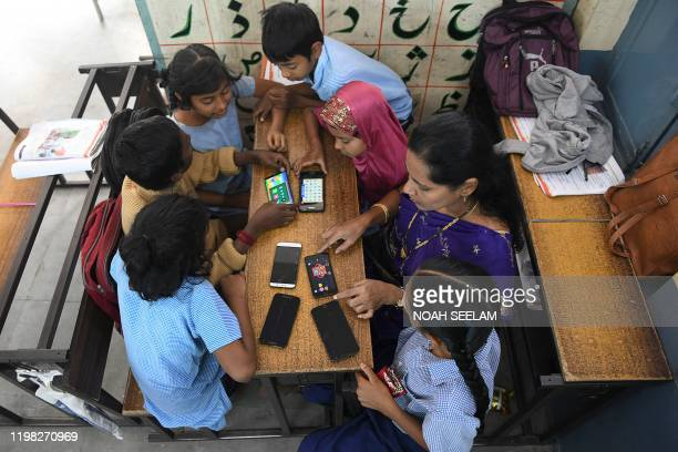 A teacher shows interactive elearning apps to students from class 1 to 5 at a government primary school in Secunderabad on February 3 2020