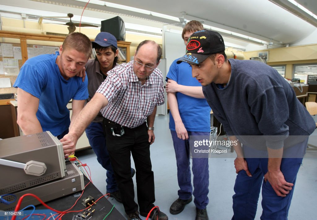 A teacher shows the prisoners and Atif (R) electronic instruments at the Iserlohn prison on May 15, 2008 in Iserlohn, Germany. The prison in North Rhine-Westphalia inhabits 292 sentenced young men between 14 and 24 years and offers school education and different technical professions.