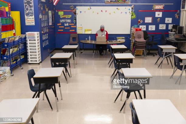 Teacher sits at her desk after conducting an online class from an empty classroom at John B. Wright Elementary School in Tucson, Arizona, U.S., on...