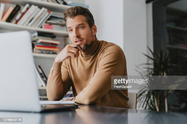 teacher sitting in the library attending an online class with his students - beige stock pictures, royalty-free photos & images