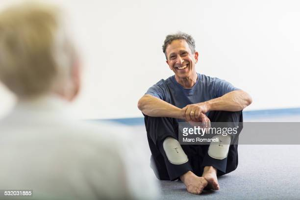 Teacher smiling at student in acting class