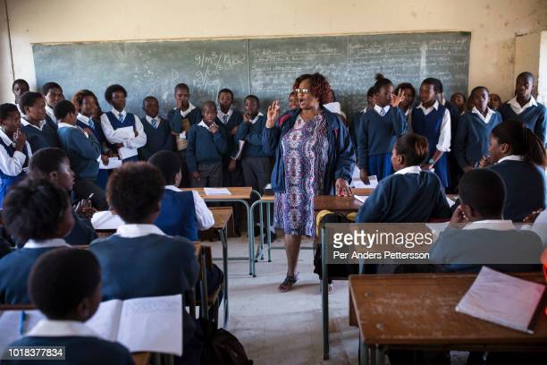 A teacher speaks to students at a class at Ndevana High School on May 7 2018 in Ndevana a rural village in Eastern Cape Province in South Africa...