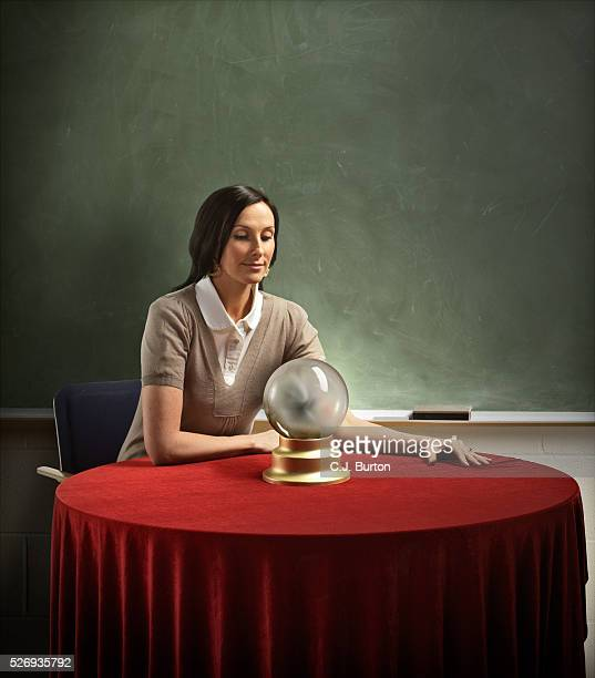 Teacher staring in to crystal ball