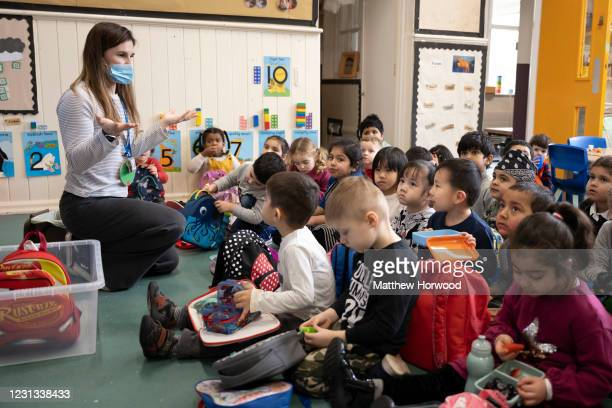Teacher take a nursery class at Roath Park Primary School on February 23, 2021 in Cardiff, Wales. Children aged three to seven began a phased return...