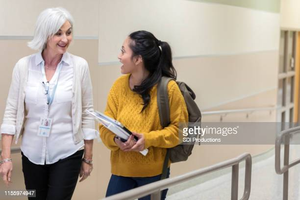 teacher takes time to walk and talk with teen - school principal stock pictures, royalty-free photos & images