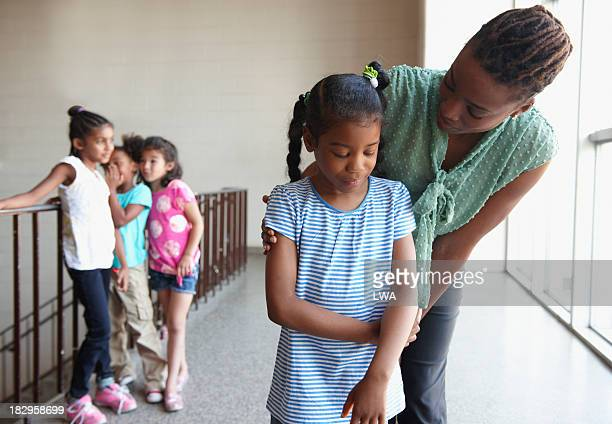 teacher talking to bullied young girl - bullying stock pictures, royalty-free photos & images