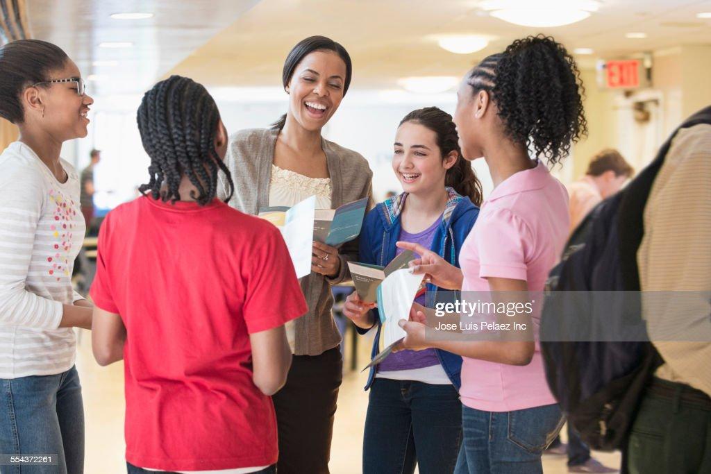 Teacher talking to children in community center : Stock Photo