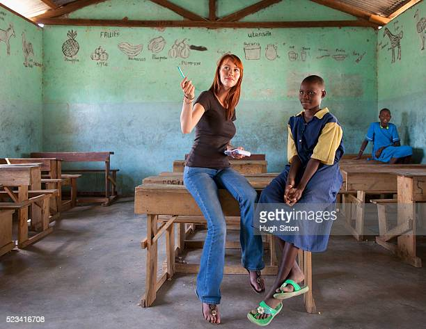 teacher talking to school girl in classroom, kenya - hugh sitton stock pictures, royalty-free photos & images