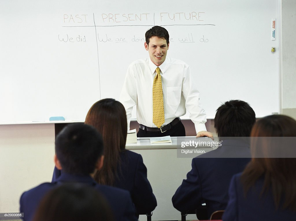 Teacher Talking to School Pupils in a Classroom : Stock Photo