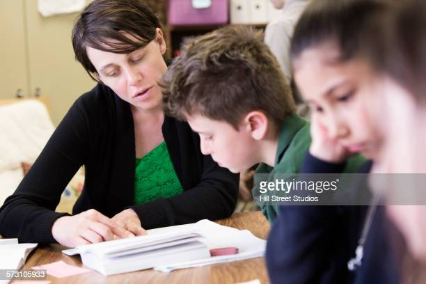 Teacher talking to student in classroom
