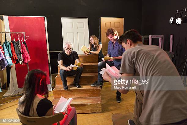 teacher talking to students in theater class - rehearsal stock pictures, royalty-free photos & images