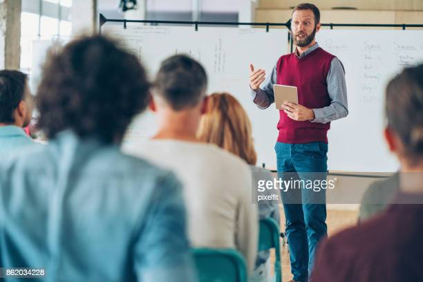 teacher talking to the class - teacher stock pictures, royalty-free photos & images