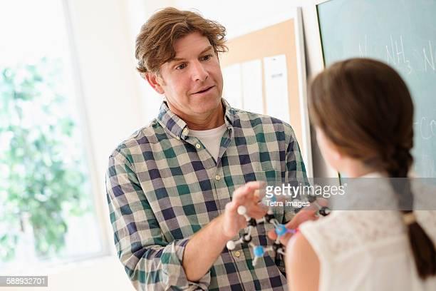 Teacher talking with girl (10-11)