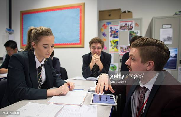 A teacher talks to a pupil during a maths lesson at the Ridings Federation Winterbourne International Academy in Winterbourne near Bristol on...