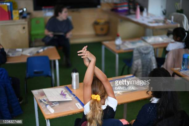 Teacher talks to her year two pupils during their first day of school after the summer break at St Luke's Church of England Primary School in East...
