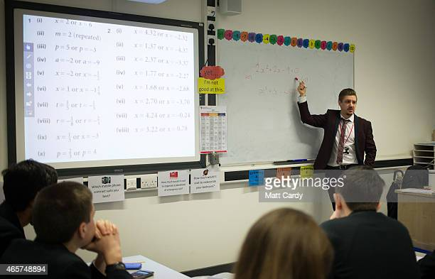 A teacher talks to pupils during a maths lesson at the Ridings Federation Winterbourne International Academy in Winterbourne near Bristol on February...