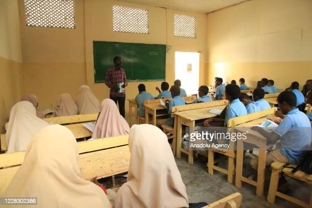 A teacher teaches in a class as schools begin in the Somalian capital Mogadishu on September 01 2020 amid the coronavirus pandemic