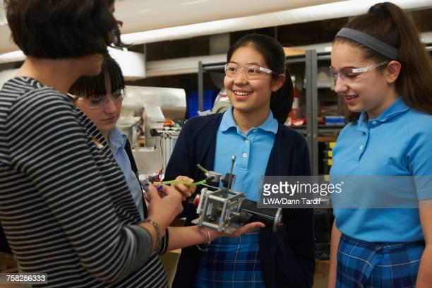 Teacher teaching engineering to girls in school