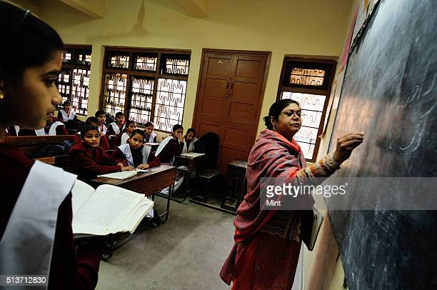 A teacher teaching in class at Sarvodaya Kanya Vidyalaya school at Lal Kuan Chandni Chowk on January 16 2013 in New Delhi India All the 1246 students...