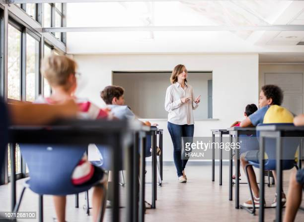 teacher teaching students in classroom - junior level stock pictures, royalty-free photos & images