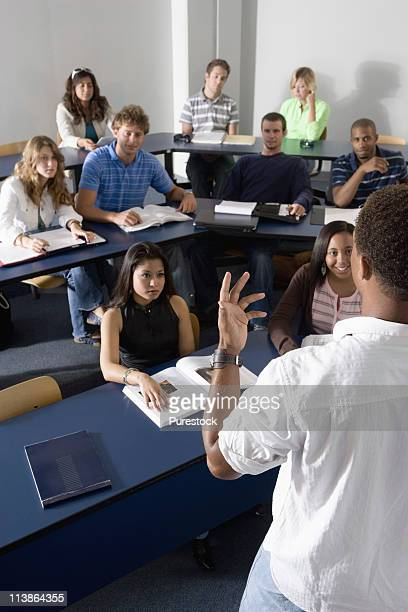 teacher teaching students in the classroom - master's degree stock pictures, royalty-free photos & images