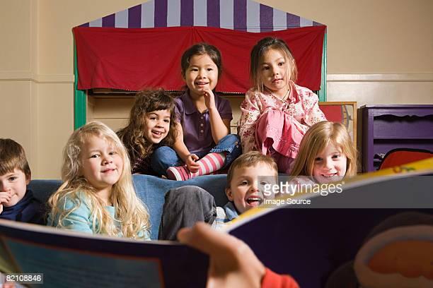 A teacher telling her class a story