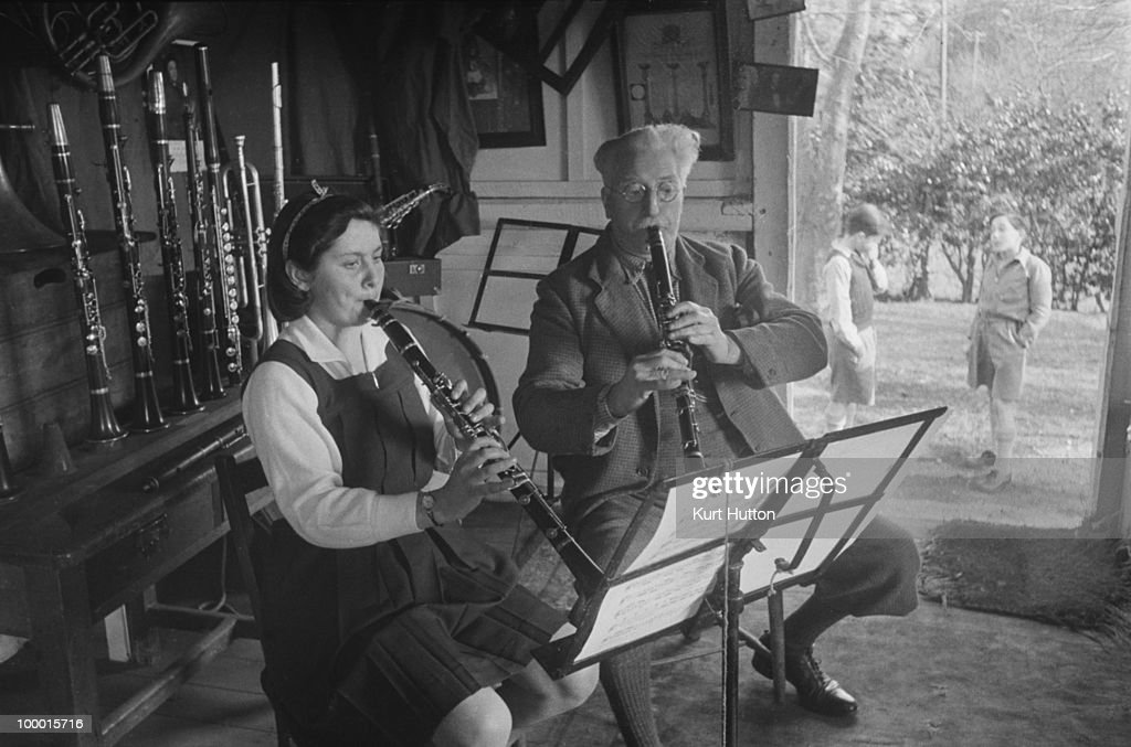Teacher Tom Holding gives a clarinet lesson at Bedales Boarding School in Steep, Hampshire, January 1941. Original publication: Picture Post - 403 - Bedales Boarding School - pub. 4th January 1941