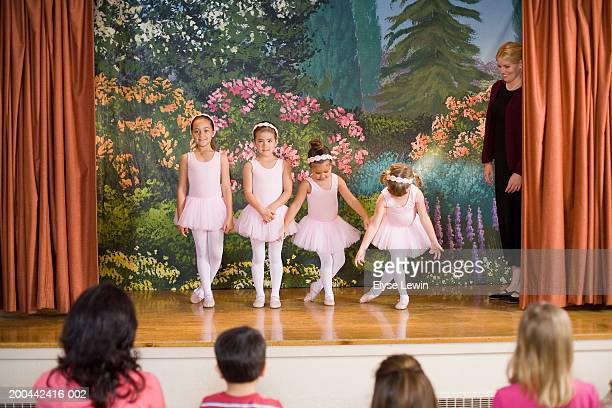 Teacher watching four ballerinas (5-9) perform on stage