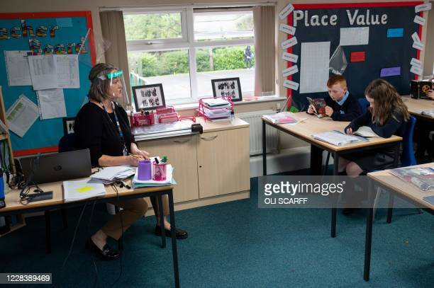Teacher wearing a face visor due to the COVID-19 pandemic, teaches year six pupils at Willowpark Primary Academy in Oldham, northern England on...